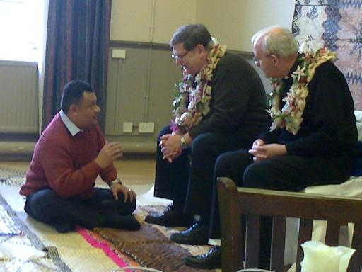 Father James and Deacon John in discussion with a Fijian visitor