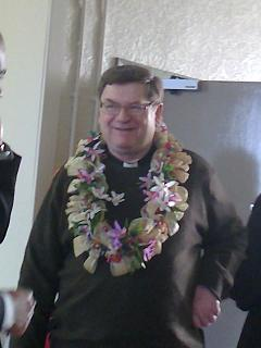 Father James wearing a Garland